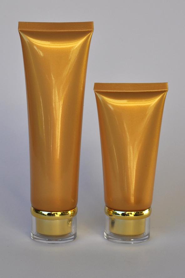 SNET-100GTGC-Pre Sealed Plastic Tube Gold 100g + Gold Cap Ø35, Clear Overcap and Metallic Gold Rim